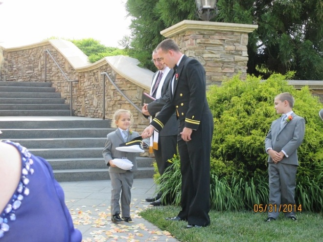The ringbearer, my youngest nephew, Elliot Thompson, was the first down Childress' grand staircase, receiving my uniform cap from me as he reached the bottom.